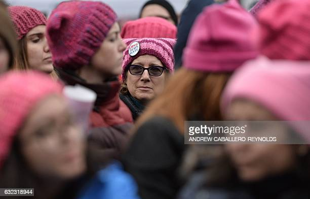 Demonstrators protest on the National Mall in Washington, DC, during the Women's March on January 21, 2017. Hundreds of thousands of protesters...