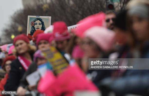 Demonstrators protest on the National Mall in Washington DC during the Women's March on January 21 2017 While the new US president has shown a...