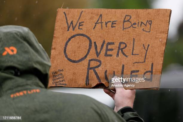 Demonstrators protest Oregonâs economicclosure efforts aimed at minimizing the lethal impact of novel coronavirus at the State Capitol in Salem...