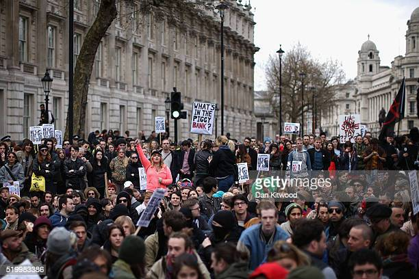 Demonstrators protest outside Downing Street on Whitehall on April 9 2016 in London England Hundreds of protesters gathered outside the Prime...