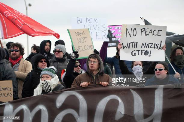 Demonstrators protest outside of a speech by white nationalist Richard Spencer who popularized the term 'altright' at Michigan State University on...