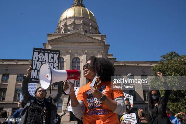 Demonstrators protest outside of the Capitol building in opposition of House Bill 531 on March 8, 2021 in Atlanta, Georgia. HB531 will restrict early...