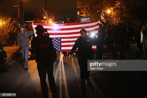 Demonstrators protest outside the Ferguson police department on October 10 2014 in Ferguson Missouri Ferguson has been plagued with protests which...