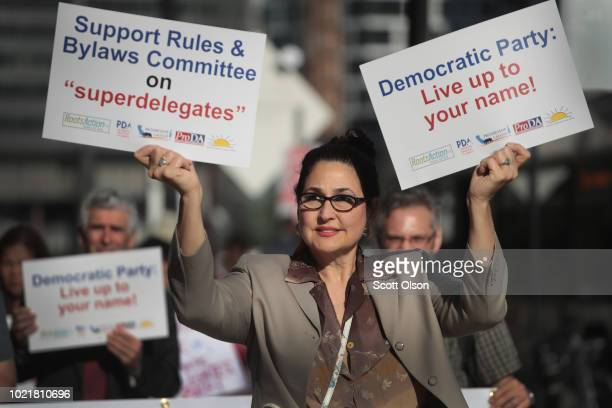 Demonstrators protest outside the Hyatt Hotel where the Democratic National Committee were kicking off their summer meeting on August 23 2018 in...