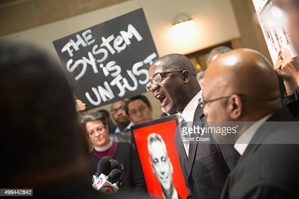 Demonstrators protest outside the office of Mayor Rahm Emanuel at City Hall following press conference where the mayor announced the firing of...