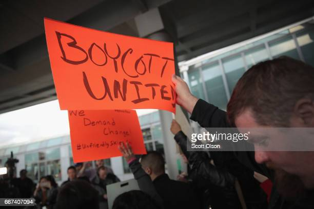 Demonstrators protest outside the United Airlines terminal at O'Hare International Airport on April 11 2017 in Chicago Illinois United Airlines has...