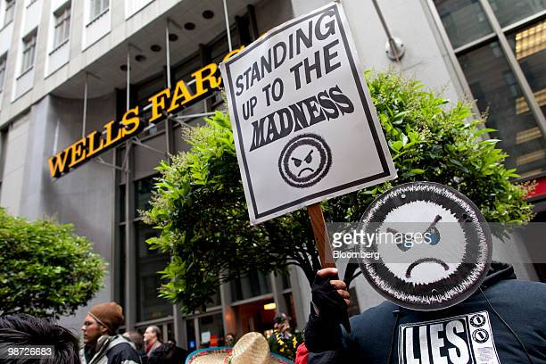 Demonstrators protest outside the venue of the Wells Fargo Co annual shareholders meeting in San Francisco California US on Tuesday April 27 2010...
