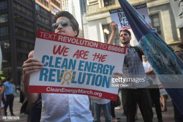Demonstrators protest President Donald Trump's decision to exit the Paris climate change accord on June 2 2017 in Chicago Illinois Yesterday in a...