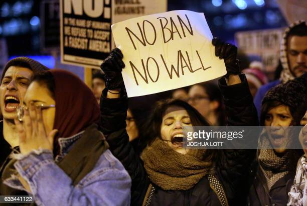 TOPSHOT Demonstrators protest President Donald Trump's executive immigration ban on February 1 2017 in Chicago Illinois Trump's order bans the...