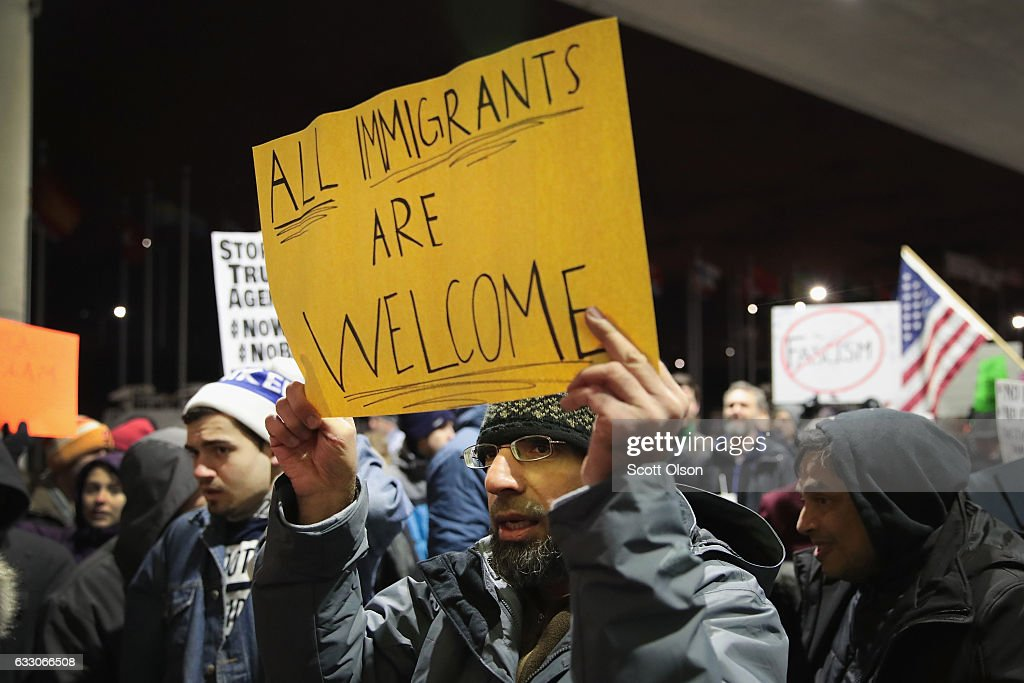 Protestors Rally At Chicago's O'Hare Airport Against Muslim Immigration Ban : News Photo