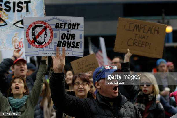 Demonstrators protest President Donald Trump's visit to Chicago outside Trump International Hotel Tower on October 28 2019 in Chicago Illinois Trump...