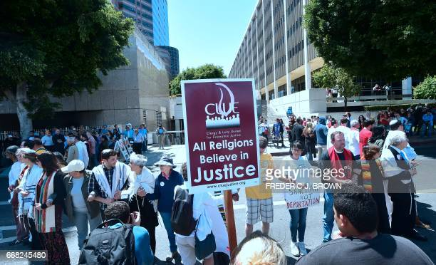 Demonstrators protest recent enforcement actions by federal Immigration and Customs Enforcement personnel outside the ICE headquarters await their...