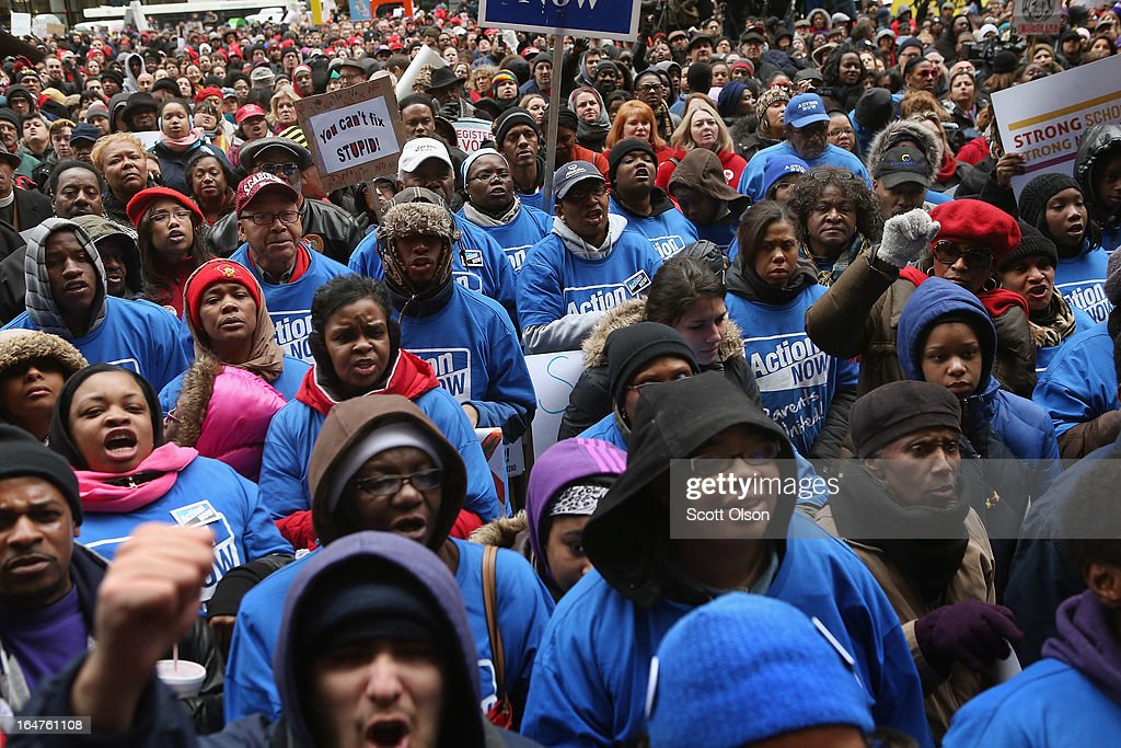 Demonstrators protest school closings on March 27, 2013 in Chicago, Illinois. More than 1,000 demonstrators held a rally and marched through downtown to protest a plan by the city to close more than 50 elementary schools, claiming it is necessary to rein in a looming $1 billion budget deficit. The closings would shift about 30,000 students to new schools and leave more than 1,000 teachers with uncertain futures.