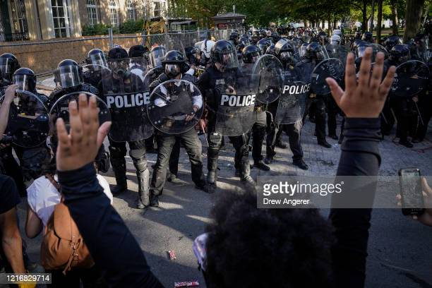 Demonstrators protest the death of George Floyd in downtown Washington DC on June 1 2020 Protests and riots continue in cities across America...