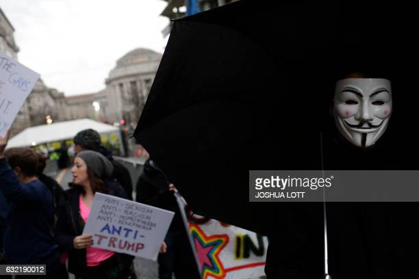 TOPSHOT Demonstrators protest the inauguration of Donald Trump on January 20 2017 in Washington DC Donald Trump will be sworn in as the 45th...