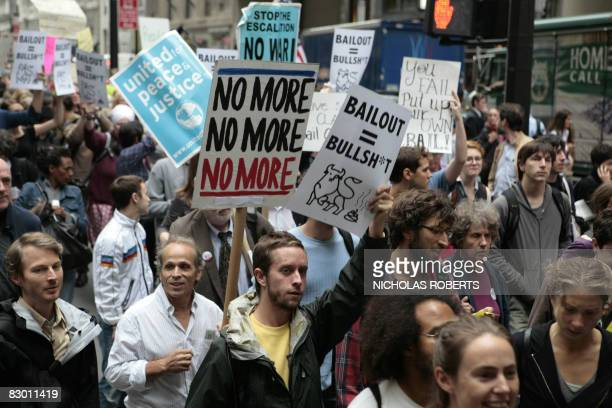 Demonstrators protest the proposed 700 billion USD Wall Street bail-out near Bowling Green Park in the Financial District in New York on September...