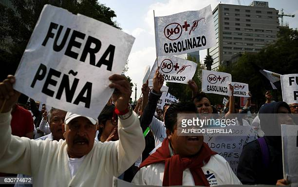 Demonstrators protest the rise in fuel prices in Mexico City on January 1 2017 On January 1 2017 fuel prices in Mexico went up 201% for gasoline and...