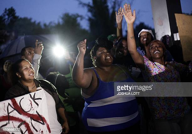 Demonstrators protest the shooting death of 18yearold Michael Brown on August 15 2014 in Ferguson Missouri Michael Brown was killed in broad daylight...