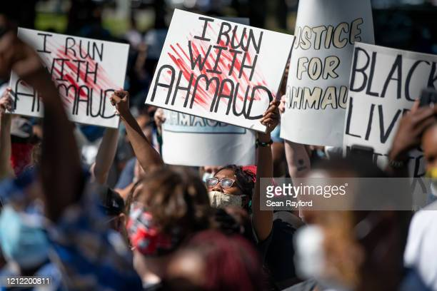 Demonstrators protest the shooting death of Ahmaud Arbery at the Glynn County Courthouse on May 8, 2020 in Brunswick, Georgia. Gregory McMichael and...