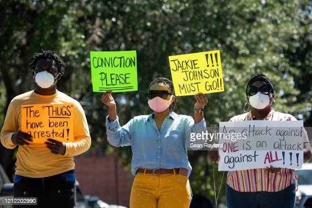 Demonstrators protest the shooting death of Ahmaud Arbery at the Glynn County Courthouse on May 8 2020 in Brunswick Georgia Gregory McMichael and...