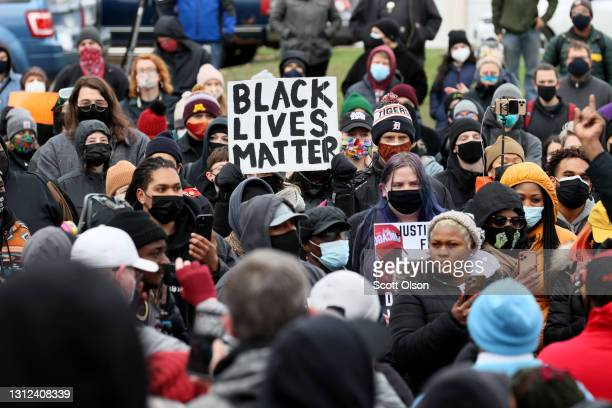 Demonstrators protest the shooting death of Daunte Wright outside the Brooklyn Center police station on April 13, 2021 in Brooklyn Center, Minnesota....