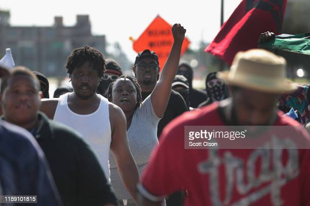 Demonstrators protest the shooting death of Eric Logan outside of the South Bend Police Station following his funeral on June 29 2019 in South Bend...