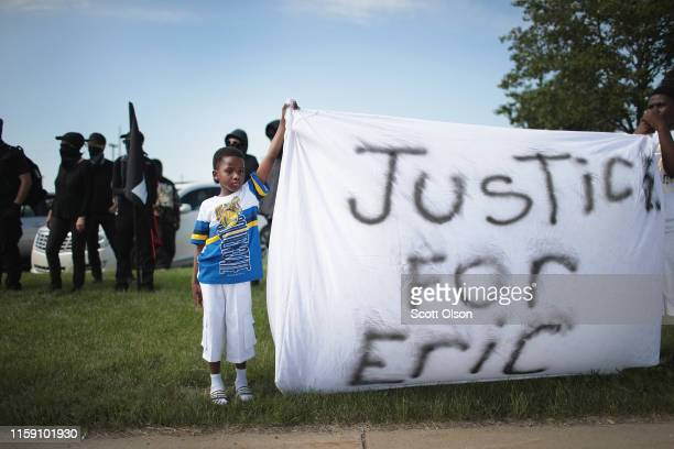 Demonstrators protest the shooting death of Eric Logan outside of the South Bend Police Station following his funeral on June 29, 2019 in South Bend,...