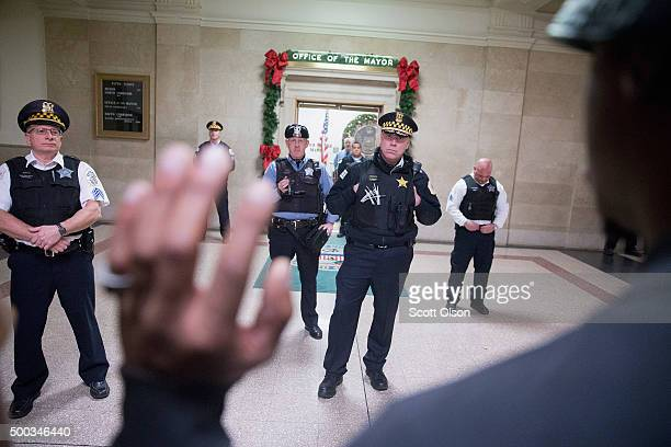 Demonstrators protest the shooting death of Laquan McDonald by a Chicago police officer outside the mayor's office in City Hall on December 7 2015 in...