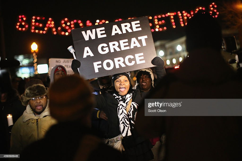 Demonstrators protest the shooting death of Michael Brown near the police station on November 21, 2014 in Ferguson, Missouri. Brown, an 18-year-old black man, was killed by Darren Wilson, a white Ferguson police officer, on August 9. A grand jury is expected to decide soon if Wilson should be charged in the shooting.