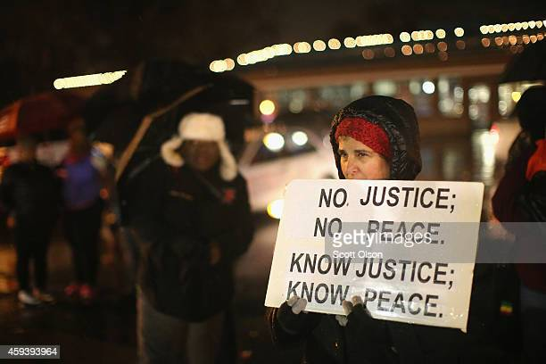 Demonstrators protest the shooting death of Michael Brown near the police station on November 21, 2014 in Ferguson, Missouri. Brown, an 18-year-old...