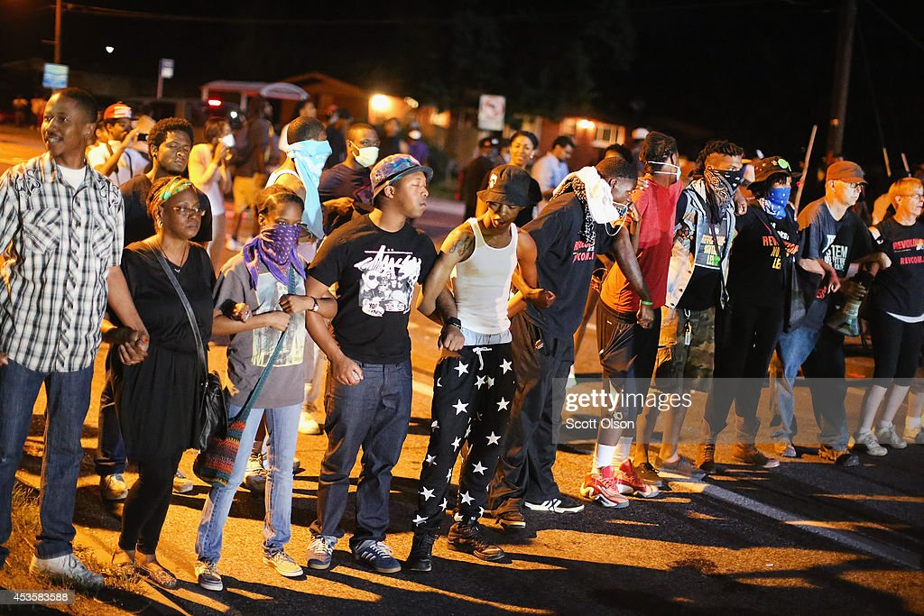 Outrage In Missouri Town After Police Shooting Of 18-Yr-Old Man : News Photo