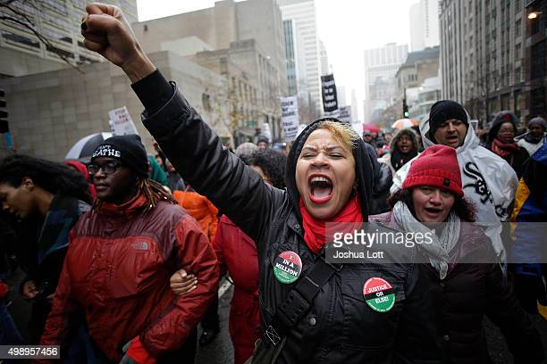 Demonstrators protest the shooting of Laquan McDonald along the Magnificent Mile November 27 2015 in Chicago Illinois Chicago police officer Jason...