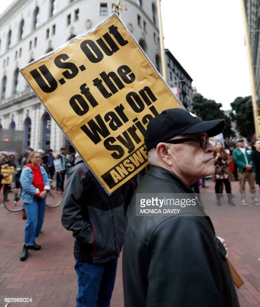 Demonstrators protest US military involvement in the Syrian war and other countries in San Francisco California on April 7 2017 The United States...