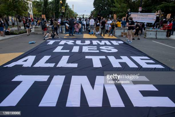Demonstrators protest U.S. President Donald Trump at Black Lives Matter plaza August 27, 2020 in Washington, DC. Protesters gathered on the final...