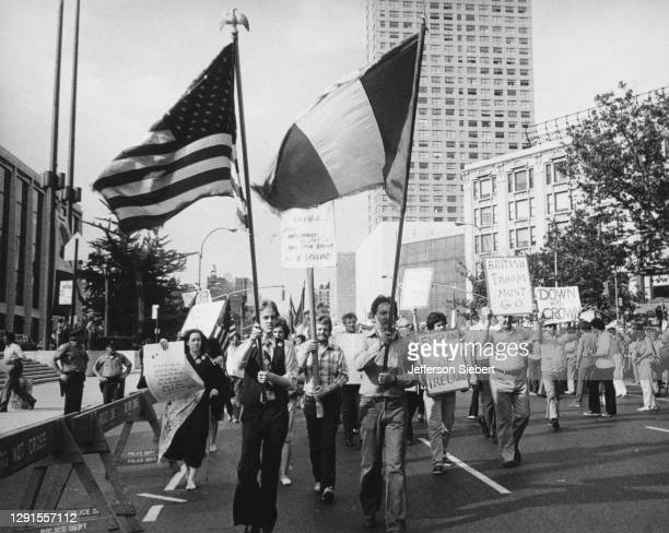 Demonstrators protesting against Britain's continued presence in Northern Ireland, with protestors waving the American flag and Irish tricolour...