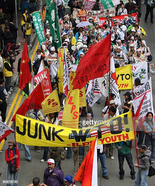 Demonstrators protesting against global trade march through the streets of Hong Kong China Tuesday December 13 2005 during first day of the World...