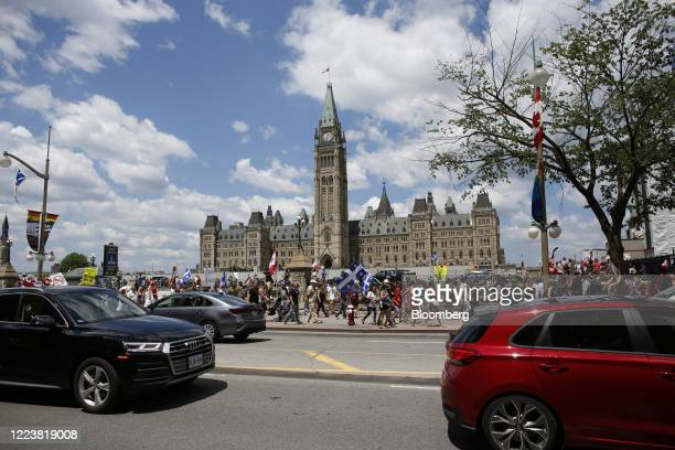 Demonstrators protesting against Prime Minister Justin Trudeau march on Canada Day in Ottawa, Ontario, Canada, on Wednesday, July 1, 2020. The...