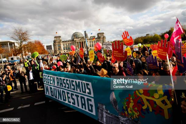 Demonstrators protesting against racism outside the Reichstag seat of the Bundestag on October 22 2017 in Berlin Germany The protest is taking place...
