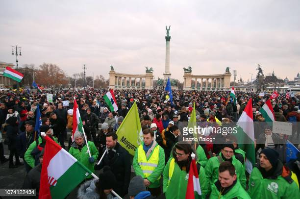 Demonstrators protesting against recent legislative measures introduced by the government of Hungarian Prime Minister Viktor Orban stand Heroes...
