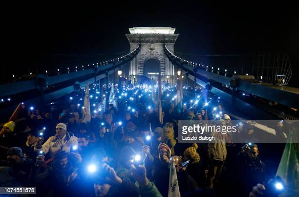 Demonstrators protesting against recent legislative measures introduced by the government of Hungarian Prime Minister Viktor Orban march towards the...