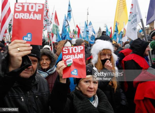 Demonstrators protesting against recent legislative measures introduced by the government of Hungarian Prime Minister Viktor Orban gather in...