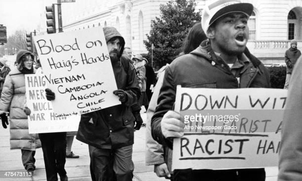 Demonstrators protesting against Secretary of State Alexander Haig blaming him for past wars Washington DC 1981