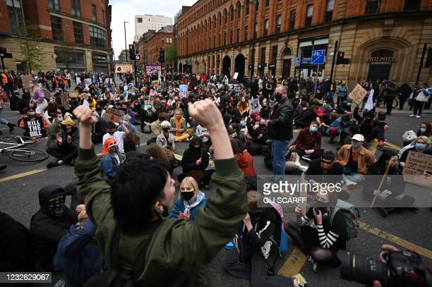Demonstrators protesting against the Police, Crime, Sentencing and Courts Bill 2021 stage a sit-in in central Manchester on May 1, 2021. - Previous...