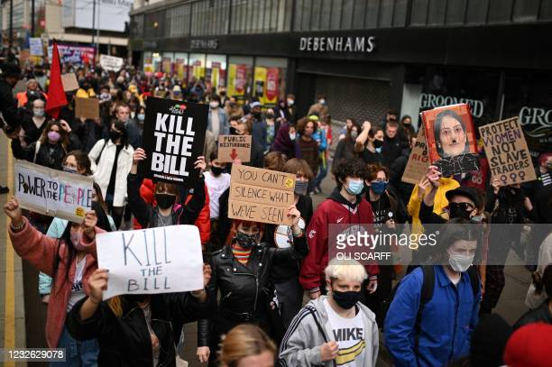 "Demonstrators protesting against the Police, Crime, Sentencing and Courts Bill 2021 march in central Manchester on May 1, 2021. - Previous ""Kill the..."