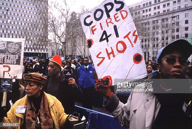 Demonstrators protesting killing of Amadou Diallo West African street peddler killed instantly by 4 white police officers from elite street crimes...
