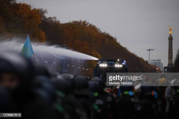 """Demonstrators protesting next to the Reichstag against modifications to a law called the """"infection protection law"""" prior to a vote on the law in the..."""