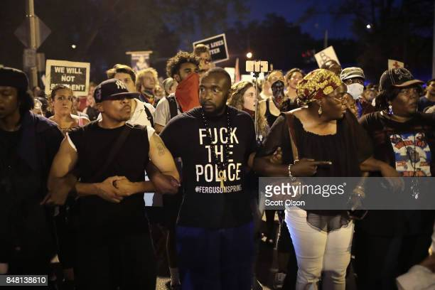 Demonstrators protesting the acquittal of former St Louis police officer Jason Stockley march through University City neighborhood on September 16...