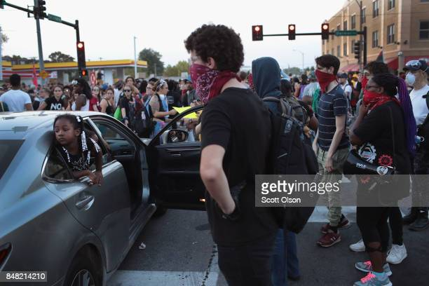 Demonstrators protesting the acquittal of former St Louis police officer Jason Stockley march through University City on September 16 2017 in St...