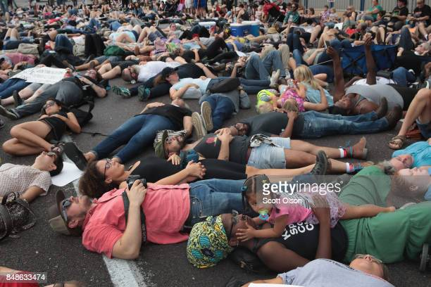 Demonstrators protesting the acquittal of former St Louis police officer Jason Stockley stage a diein in front of police headquarters on September 17...