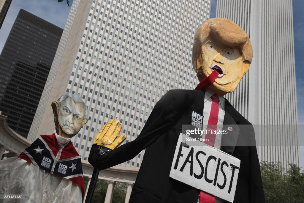 Demonstrators protesting the alt-right movement and mourning the victims of yesterdays rally in Charlottesville, Virginia carry puppets of President Donald Trump and U.S. Attorney General Jeff Sessionson August 13, 2017 in Chicago, Illinois. One person was killed and 19 others were injured in Charlottesville when a car plowed into a group of activists who were preparing to march in opposition to a nearby white nationalists rally. Two police officers were also killed when a helicopter they were using to monitor the rally crashed.